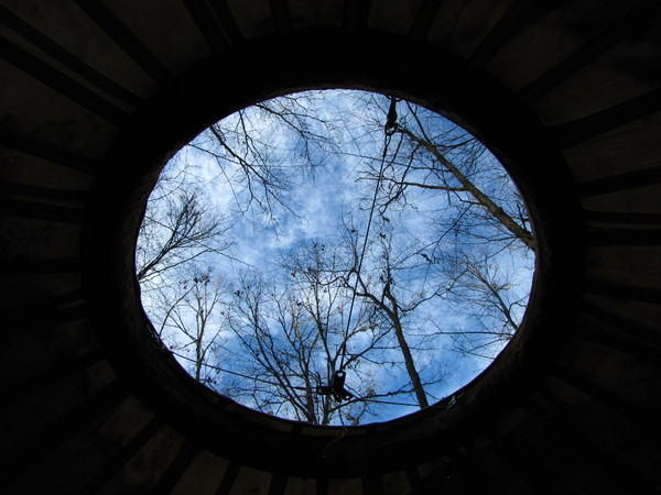 blue circle of sky seen&#10;through the center of the yurt