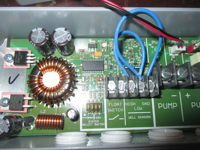 circuit board with terminals labeled PUMP, PV, HIGH, LOW, GND, FLOAT SWITCH