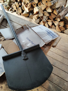 just unboxed trenching tool looks like a large black metal spatula