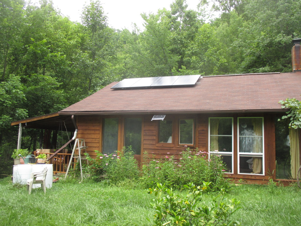 house with 4 solar panels on roof