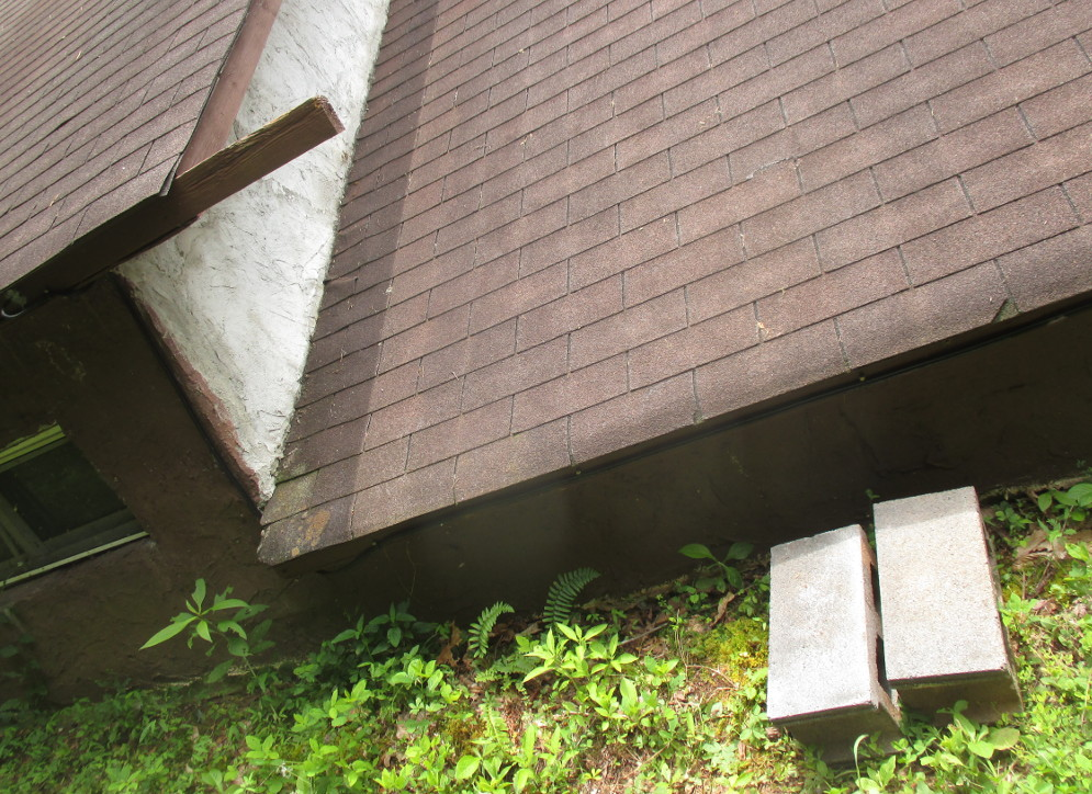 roof next to the ground with a couple of cinderblock steps